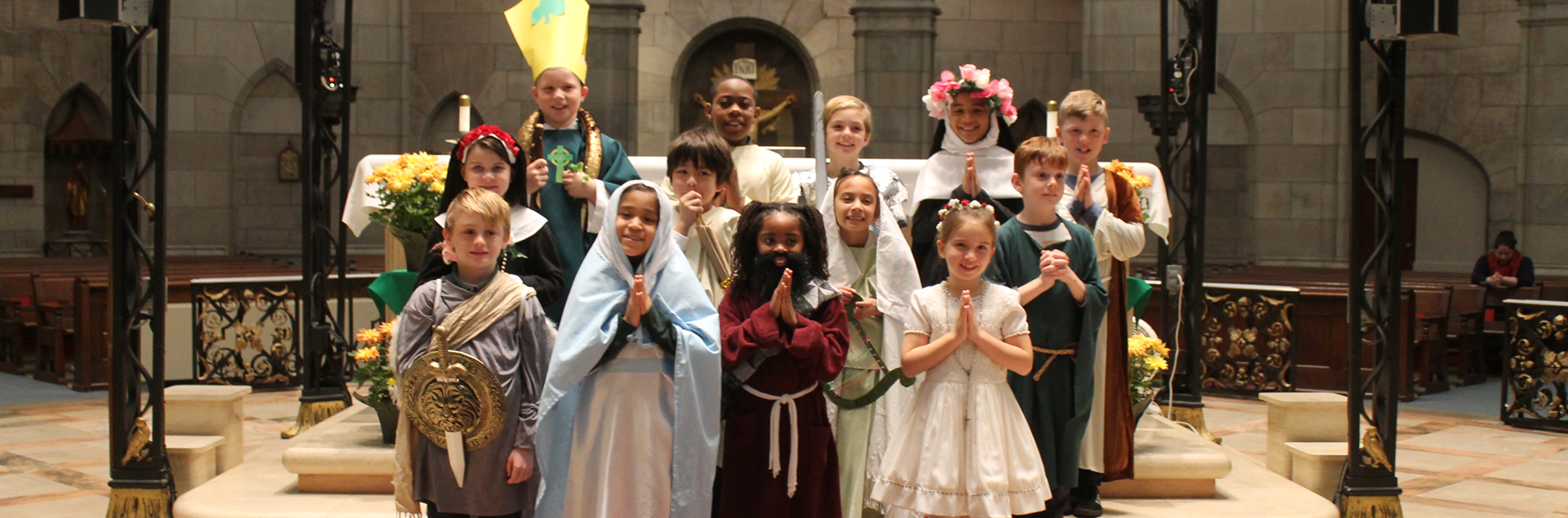 Kids dressed for All Saints Mass