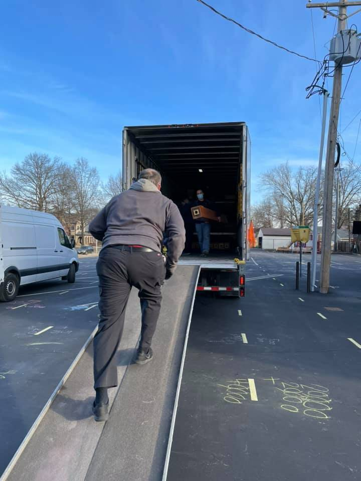 Unloading the truck- refinished wood pipes